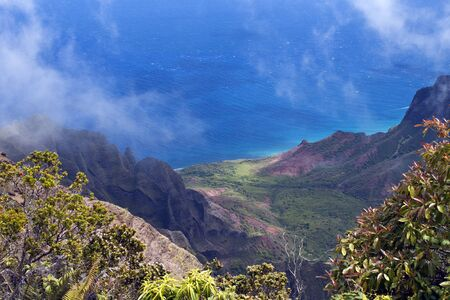 Na Pali Coast from Waimea Canyon with clouds, mountains, and valley leading to the coast
