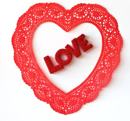 The word Love in a Doily Heart on a white background