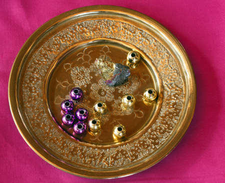 pyrite: Brass Plate with assorted beads in Madi Gras colors. GOld Pyrite rock with Fuschia striations.