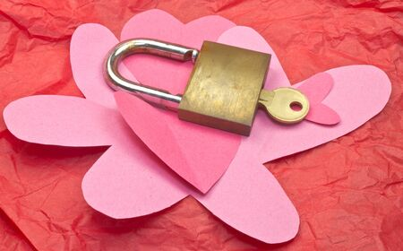 Homemade hearts with lock and key on red tissue paper Stock Photo - 11980964