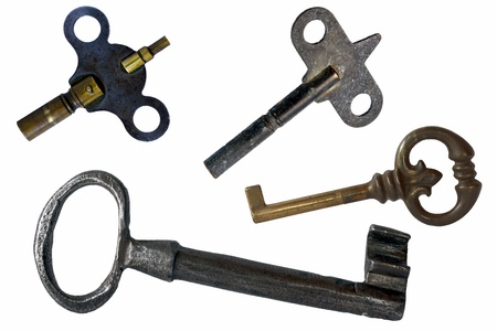 Assorted antique keys isolated on a white background photo
