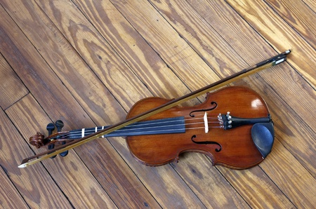 bluegrass: Fiddle with bow on a wooden Dance Floor. Vintage 1950s. Stock Photo
