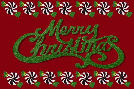 The words Merry Christmas with candy border on a red background photo