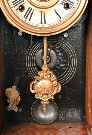 pendulum: Antique clock works showing the pendulum, springs, chimes and part of the face