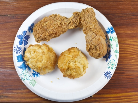 Fried Chicken fast food on a papr plate and wooden table