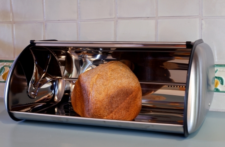Homemade whole wheat bread in a stainless steel open bread box  photo