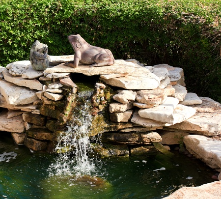 statutes: Waterfeature with frog statues in a garden Stock Photo