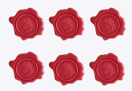 Sealing wax with inprint isolated on a white background photo