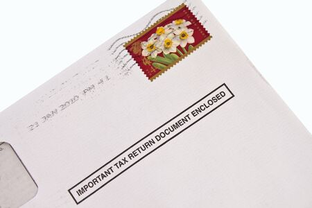 envelope: Envelope with tax form and stamp isolated