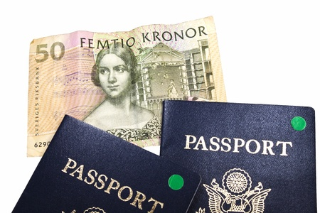 Swedish 50 Kronor bank note with 2 passports isolated with clipping path