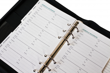 adresses: Address book isolated. A place for adresses in a ringed, black binger with a zipperd Stock Photo