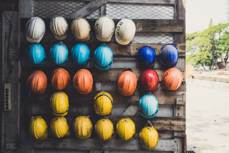 Safety Helmets are hanging on the wood wall Stock Photo - 52946477