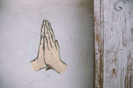 Wall painting of hands press together