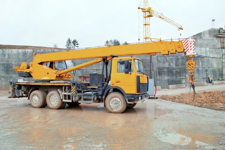 mobile crane: Truck crane standing on a construction site under construction hydropower plants in Grodno Belarus Stock Photo