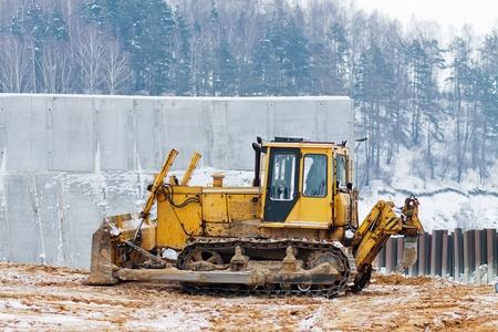 ripper: bulldozer loader at winter frozen soil excavation works