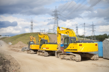 dragline: three excavators standing at the construction site of Grodno hydroelectric power station Editorial
