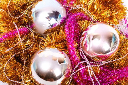 colorful Christmas decorations lying in tinsel photo