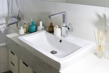 luxury house: Bathroom with washbasin and glass bottles Stock Photo