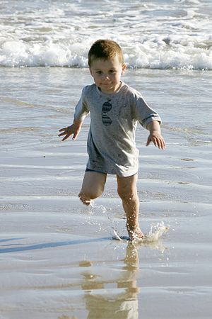 2 year old toddler A beach Stock Photo