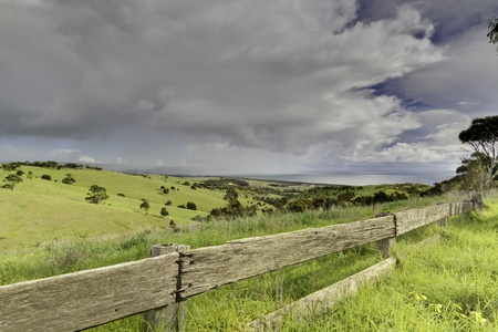 new scenery: View across a rural pasture with storm clouds rolling in. Stock Photo