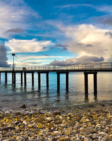 HDR image of Rapid Bay Jetty South Australia, Bench Seat and Solar Light, with storm clouds rolling in.