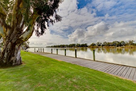 Murray River flowing along side a park, Manum South Australia.