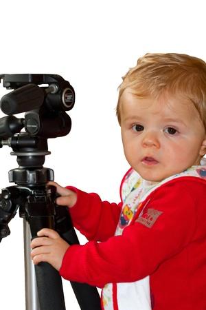 Baby boy Holding onto a Tripod Stock Photo