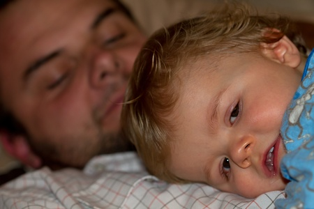 Sick ten month old baby cuddling with his Grandfather