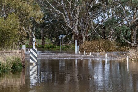 Road closed due to flooding showing water depth marker