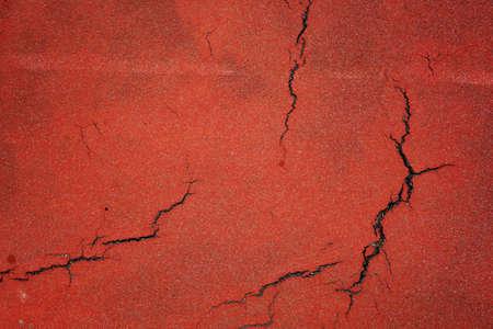 old orange cracked bike path background Фото со стока