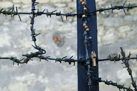 wooden rosary hanging off a monument commemorating Polish victims of German nazis from 2nd world war
