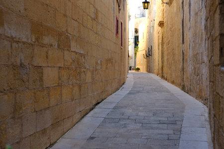 Narrow street of the ancient city of Mdina, Malta