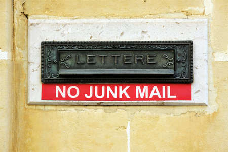 decorative metal letter box with a 'no junk mail' message below