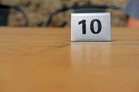 Number ten tag on a wooden table in a restaurant