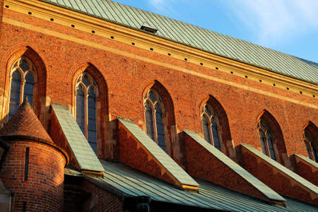 Gothic brick wall with widows - architectural detail of the Saint John the Baptist Cathedral in Ostrow Tumski, Wroclaw, Poland.