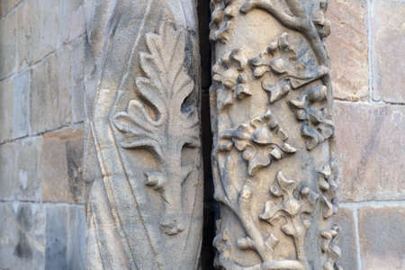 closeup detail of geometrical and floral patterns carved in stone at the entrence to the gothic cathedral of St. John the Baptist in Wroclaw, Poland Standard-Bild