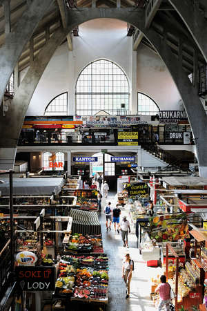 Wroclaw, Poland 08/28/2020. Interior of the city market hall selling groceries and flowers from the beginning of the 20th century. Designed by German architect Richard Pluddemann and is famous for its innovative use of reinforced concrete.