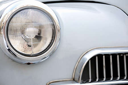 Close-up of a vintage car front headlight with copy space.