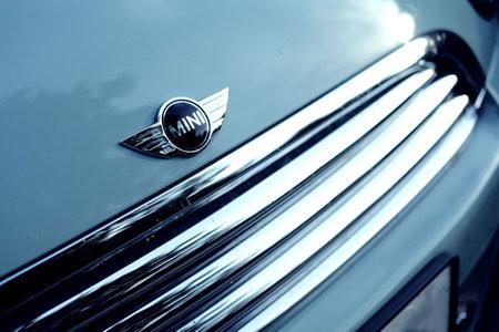 Lublin, Poland 09/20/2020 closeup of aa mini car logo on blue hood.
