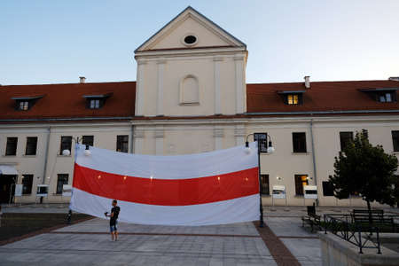 Lublin, Poland. 09/12/2020 White-red-white flag hung in front of a building as a sign of solidarity with Belarus and its people fighting with the regime.