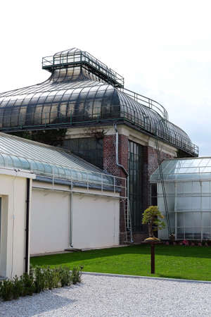 Ksiaz Wielki, Poland 08/19/2020 historic palm house built of steel, glass and brick in old botanical garden Editorial