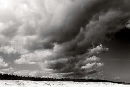 dramatic clouds over sandy beach at the coast- blacka and white landscape, horizon, outdoor, background, travel, shore, coastline, outdoors, tourism, dark, scene