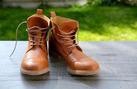 pair of orange genuine leather handmade boots