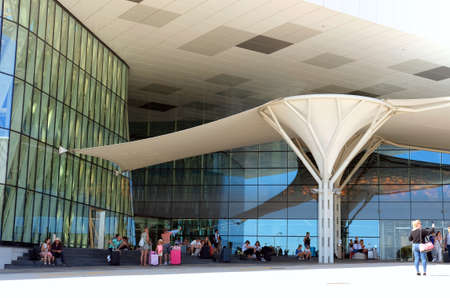 Split, Croatia. August 18, 2012. Tourists waiting outside the airport for their flight home