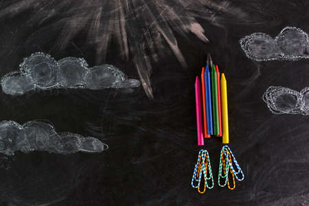 Rocket made out of crayons. on a blackboard