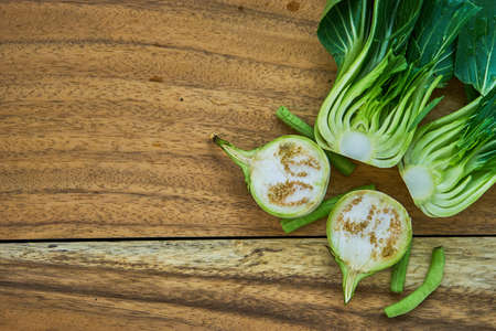 national fruit of china: Shanghai Bok Choy, on wood Top view