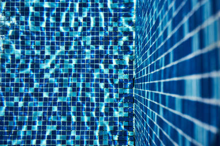 Blue swimming pool lido tile background texture
