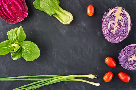 genetically modified crops: young onions, Red Cabbage, parsley beetroots, on blackboard background