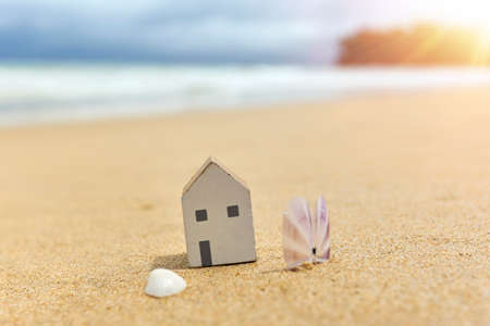 Small toy house on the beach