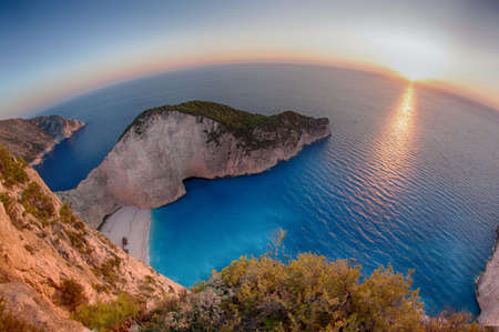 Beautifull sunset at Navagio Bay in Zakynthos, Greece, the place of the most known shipwreck in the world photo